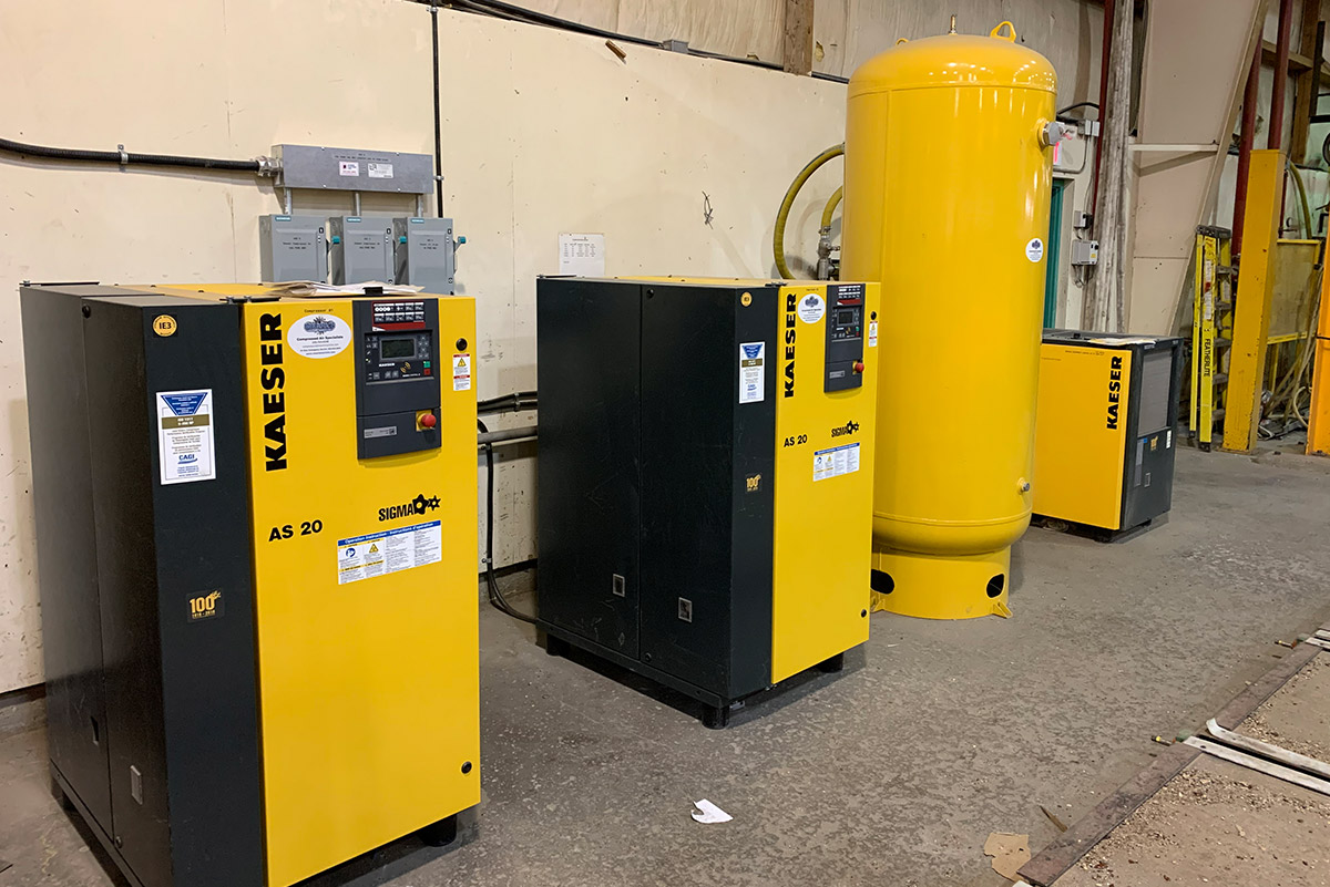 Yellow Kaeser AS 20 compressed air solutions on shop floor